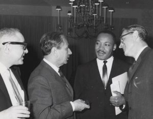 Joachim Prinz, second from left speaking with Martin Luther King Jr. in 1963. Photo The American Jewish Historical Society.